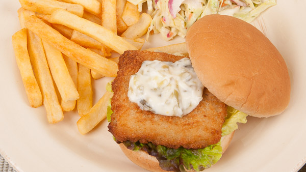Fish Sandwich with Fried Potatoes and Coleslaw
