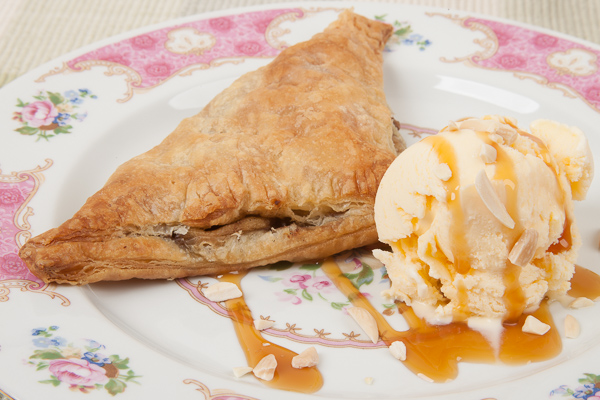 Homemade apple turnover with ice cream.